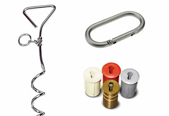 A aluminum carabiner, a steel screw peg and four anchor on the white background.