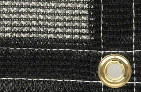 A piece of knitted pond netting with a brass grommet on the edge.